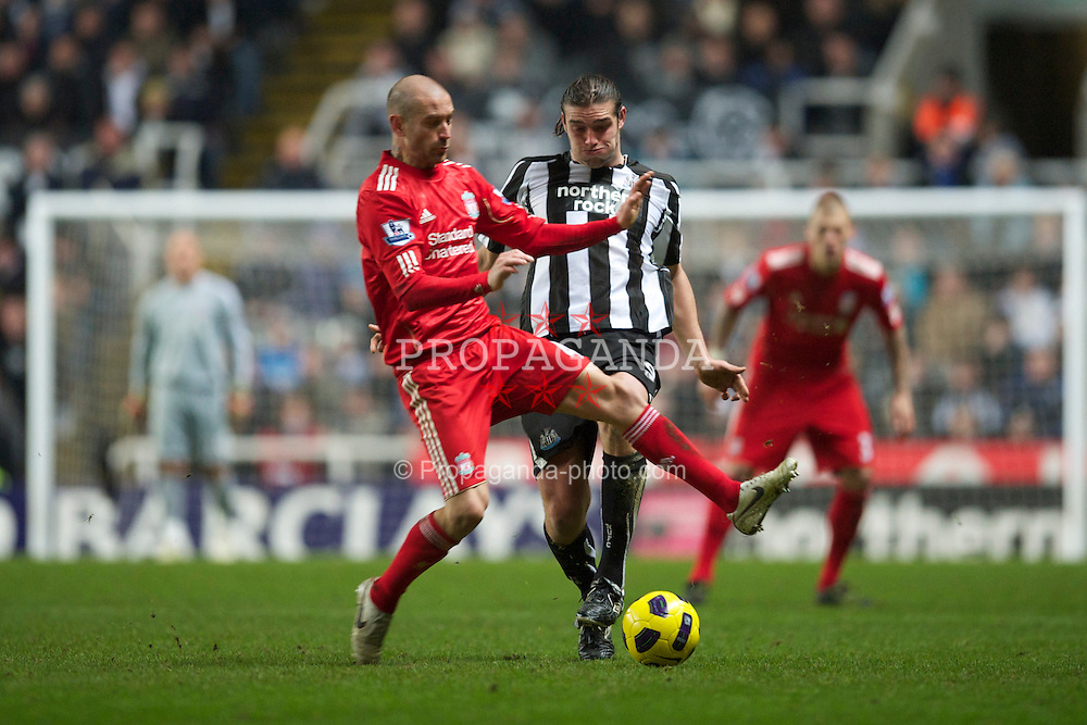NEWCASTLE, ENGLAND - Saturday, December 11, 2010: Liverpool's Raul Meireles and Newcastle United's Andy Carroll during the Premiership match at St James' Park. (Photo by: David Rawcliffe/Propaganda)