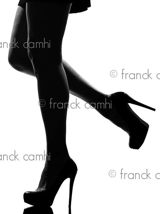 stylish silhouette caucasian beautiful woman legs shoes high heels  stileletto silhouette on studio isolated white background