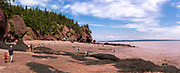 Tourists visit Hopewell Rocks, a provinicial park on the Bay of Fundy, New Brunswick, Canada.