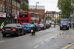 © Licensed to London News Pictures. 28/04/2020. London, UK. Traffic on Wood Green High Road, north London. There has been an increase in traffic across London as more high street shops, cafes and DIY stores start to open during coronavirus lockdown. The lockdown continues to slow the spread of COVID-19 and reduce pressure on the NHS. Over 21,000 people in the UK have died in hospitals due to the virus. Photo credit: Dinendra Haria/LNP