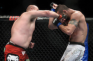 """LONDON, ENGLAND, OCTOBER 2010: Rob Broughton (left) connects with a right hoot to the jaw of Vinicius Queiroz during """"UFC 120: Bisping vs. Akiyama"""" inside the O2 Arena in Greenwich, London"""