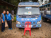 26 OCTOBER 2016 - NUPO TEMPORARY SHELTER, MAE CHAN, TAK, THAILAND:  Officials in the Nupo Temporary Shelter refugee camp get buses ready to take Burmese refugees back to Myanmar. Sixtyfive Burmese refugees living in the Nupo Temporary Shelter refugee camp in Tak Province of Thailand were voluntarily repatriated to Myanmar. About 11,000 people live in the camp. The repatriation was the first large scale repatriation of Myanmar refugees living in Thailand. Government officials on both sides of the Thai / Myanmar border said the repatriation was made possible by recent democratic reforms in Myanmar. There are approximately 150,000 Burmese refugees living in camps along the Thai / Myanmar border. The Thai government has expressed interest several times in the last two years in starting the process of repatriating the refugees.    PHOTO BY JACK KURTZ