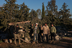 Rebel soldiers from brigade Abdala Mubarak from the battalion 'The Nation' looks at the photographers camera in front of a captured tank from Kafranbel on August 2012 covered with branches to hide it from Airplanes, Syria, February 12, 2013. Photo by Daniel Leal-Olivas / i-Images...