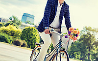 Portrait of young attractive businessman riding bicycle