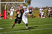 Logan Granera '13 dives for a pass just out of reach in front of Kyle Gauthier '11 during Saturday's 31-17 victory over Lawrence University on Rosenbloom Field.