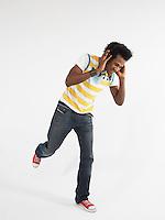 Man dancing while wearing headphones in studio