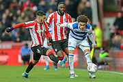 Brentford forward Saïd Benrahma (10) battles for possession Queens Park Rangers midfielder Luke Amos (8) during the EFL Sky Bet Championship match between Brentford and Queens Park Rangers at Griffin Park, London, England on 11 January 2020.