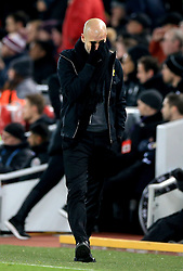 Manchester City manager Pep Guardiola appears dejected during the Premier League match at Anfield, Liverpool.