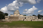 The Astronomical Observatory, called El Caracol (Snail) because of the spiral staircase inside it, rectangular platform of 67 meters from north to south and 52 meters from east to west with a cylindrical tower standing on it, about 16 meters high, Toltec architecture, 900-1100 AD, Chichen Itza, Yucatan, Mexico. Picture by Manuel Cohen