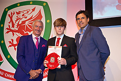 NEWPORT, WALES - Saturday, May 21, 2016: Ryan Reynolds is presented with his Under-16's cap by Wales' Elite Performance Director Ian Rush and National Team Manager Chris Coleman at the Celtic Manor Resort. (Pic by David Rawcliffe/Propaganda)