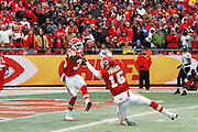 Ricky Price (35) and Verran Tucker (15) of the Kansas City Chiefs try to down a punt near the goal line against the Baltimore Ravens during the AFC Wild Card Playoff game at Arrowhead Stadium on Jan. 9, 2011 in Kansas City, MO.