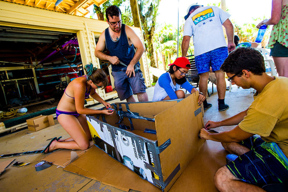 SARASOTA, FL -- August 21, 2016 -- Students at New College of Florida enjoy the cardboard boat regatta and waterfront party at Caples during orientation week for the start of the 2016-17 academic year. (PHOTO / New College of Florida, Chip Litherland)