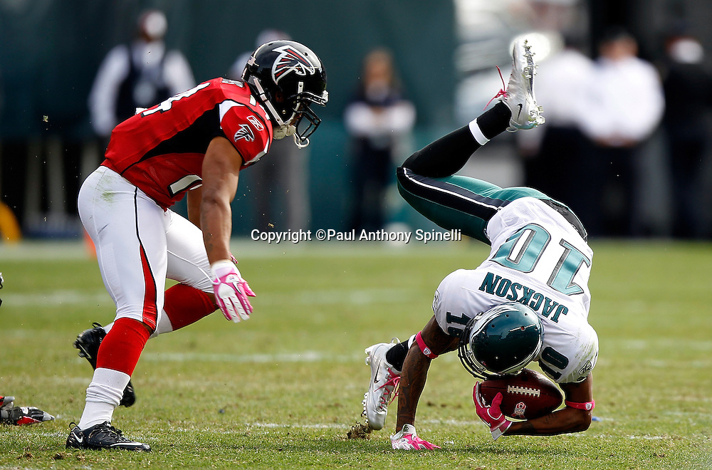 Philadelphia Eagles wide receiver DeSean Jackson (10) tries to regain his balance as he gets upended during the NFL week 6 football game against the Atlanta Falcons on Sunday, October 17, 2010 in Philadelphia, Pennsylvania. The Eagles won the game 31-17. (©Paul Anthony Spinelli)