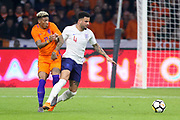 Netherlands Defender Patrick van Aanholt (Crystal Palace) battles with England defender Kyle Walker during the Friendly match between Netherlands and England at the Amsterdam Arena, Amsterdam, Netherlands on 23 March 2018. Picture by Phil Duncan.