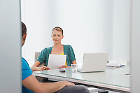 Woman talking to man in office
