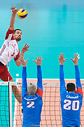 Poland, Warsaw - 2017 August 24: (L) Dawid Konarski from Poland spikes against Uros Kovacevic and Srecko Lisinac both from Serbia during LOTTO EUROVOLLEY POLAND 2017 - European Championships in volleyball at Stadion PGE Narodowy on August 24, 2017 in Warsaw, Poland.<br /> <br /> Mandatory credit:<br /> Photo by &copy; Adam Nurkiewicz<br /> <br /> Adam Nurkiewicz declares that he has no rights to the image of people at the photographs of his authorship.<br /> <br /> Picture also available in RAW (NEF) or TIFF format on special request.<br /> <br /> Any editorial, commercial or promotional use requires written permission from the author of image.
