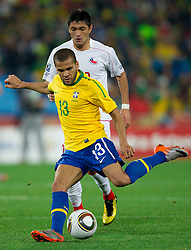 Dani Alves of Brazil vs Rodrigo Millar of Chile during the 2010 FIFA World Cup South Africa Round of Sixteen match between Brazil and Chile at Ellis Park Stadium on June 28, 2010 in Johannesburg, South Africa.  (Photo by Vid Ponikvar / Sportida)