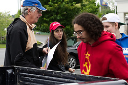 Local activist mount protest prepare ahead of an anti-KKK protest, in Southern Lancaster County, Pennsylvania, on May 20, 2017. Activist gather on a parking lot ahead of a drive over back country roads to protest the plans of a cross lighting of a Maryland based Ku Klux Klan chapter in QuarryVille, PA.