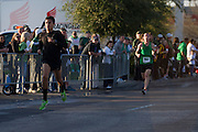 Eduardo Rodriguez sprints to the finish line to win the Dash Down Greenville 5k with Boo Bryant following close behind on Saturday, March 16, 2013. Rodriguez missed registration giving Bryant the victory. (Cooper Neill/The Dallas Morning News)