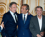 """Michel Drucker, Jacky Ickx, Salvatore Adamo attends at the ceremony who Michel Drucker was awarded at  the title of Commander of the Order of the Crowne at the Palace Egmont"""" at Brussels, 2014 in Brussels, Belgium."""