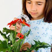 Girl using magnifying lens to