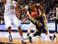 WEST LAFAYETTE, IN - JANUARY 27: Roy Devyn Marble #4 of the Iowa Hawkeyes dribbles the ball to the basket against A.J. Hammons #20 of the Purdue Boilermakers at Mackey Arena on January 27, 2013 in West Lafayette, Indiana. Purdue defeated Iowa 65-62 in overtime. (Photo by Michael Hickey/Getty Images) *** Local Caption *** Roy Devyn Marble