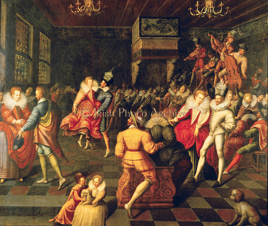 Ball at the Valois Court'. Couple on centre right are dancing the Volta, a favourite dance of Elizabeth I of England. The string band is playing on  a platform, top left.    16th century French school.