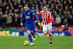 Wayne Rooney of Manchester United is challenged by Geoff Cameron of Stoke City - Photo mandatory by-line: Rogan Thomson/JMP - 07966 386802 - 01/01/2015 - SPORT - FOOTBALL - Stoke-on-Trent, England - Britannia Stadium - Stoke City v Manchester United - New Year's Day Football - Barclays Premier League.