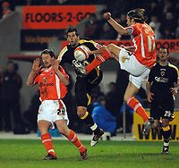 MATTHEW POVER PICTURE                                                +447971 184305<br /> <br /> 11/12/07 .... Blackpool v Cardiff<br /> Cardiff's Joe Ledley is challenged by Blackpool's Michael Flynn (left) and Kaspars Gorkss.