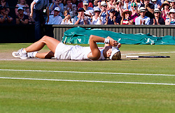 LONDON, ENGLAND - Saturday, July 14, 2018: Angelique Kerber (GER) collapses to the floor as she celebrates winning the Ladies' Singles Final match 6-3, 6-3 on day twelve of the Wimbledon Lawn Tennis Championships at the All England Lawn Tennis and Croquet Club. (Pic by Kirsten Holst/Propaganda)