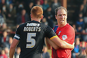 Cambridge United defender Mark Roberts  has a hold of York City defender Keith Lowe during the Sky Bet League 2 match between York City and Cambridge United at Bootham Crescent, York, England on 3 October 2015. Photo by Simon Davies.