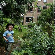Link&ouml;ping, Sweden, August 19, 2012.<br /> A boy plays in the garden of Stolplyckan co-housing, the second biggest collective in Sweden with 184 apartments.<br /> <br /> Link&ouml;ping, Svezia, Agosto 2012.<br /> Un ragazzo gioca nel giardino comune del collettivo Stolplyckan, il secondo pi&ugrave; grande in Svezia, che comprende 184 appartamenti.