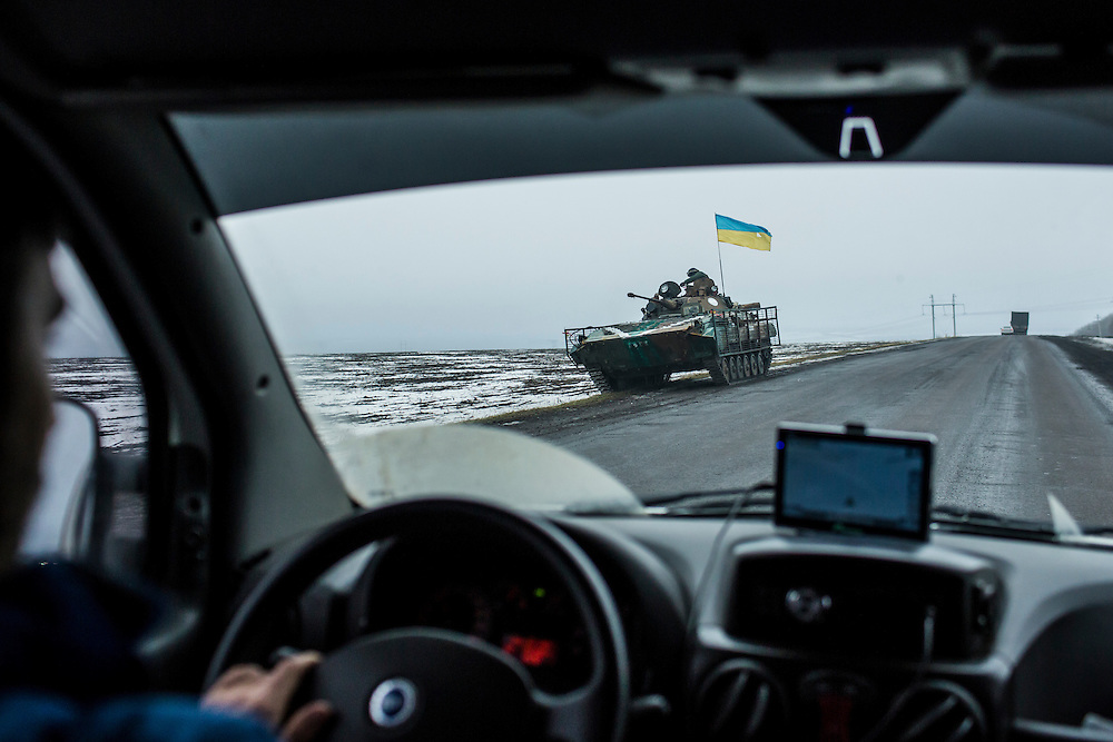 KURAKHOVE, UKRAINE - JANUARY 22, 2015: A Ukrainian armored personnel carrier on a road in Kurakhove, Ukraine. The front lines between Ukrainian and rebel control are about 20 kilometers away. CREDIT: Brendan Hoffman for The New York Times