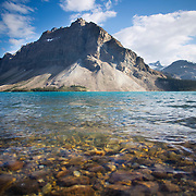 The teal waters of glacial-fed Bow Lake, in Banff National Park, Canada. The view from Simpson's Num-Ti-Jah Lodge in the Canadian Rockies.