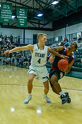 BLOOMINGTON, IL - November 12: Luke Yoder defends Karson Hayes during a college basketball game between the IWU Titans  and the Blackburn Beavers on November 12 2019 at Shirk Center in Bloomington, IL. (Photo by Alan Look)