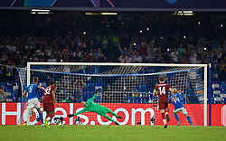 NAPLES, ITALY - Tuesday, September 17, 2019: SSC Napoli's Dries Mertens scores the first goal past Liverpool's goalkeeper Adrián San Miguel del Castillo from a penalty kick during the UEFA Champions League Group E match between SSC Napoli and Liverpool FC at the Studio San Paolo. Napoli won 2-0. (Pic by David Rawcliffe/Propaganda)