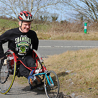 A wheelchair participant enjoys competing in the Pakie Ryan Memorial 10 k Race in Newmarket on Saturday.