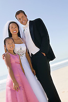 Bride and Groom with sister on beach (portrait)