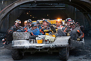 Emerging from the portal after a 10-hour shift, a dozen of coal miner Todd Kincer's colleagues lounge on the ?man car? that transports them to and from the coal face, several miles into the mountain, at the Advantage One Mine outside Whitesburg, Kentucky. (From the book What I Eat: Around the World in 80 Diets.)