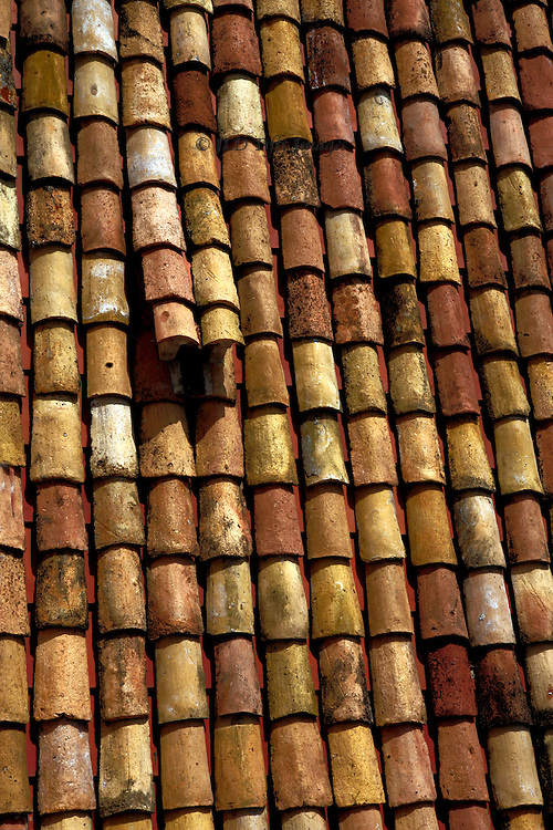 Cylindrical roof tiles, originals saved after the war, restored to Dubrovnik roofs supported on modern manufactured tiles underneath.