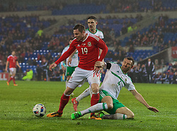 CARDIFF, WALES - Thursday, March 24, 2016: Wales' Simon Church is brought down by Northern Ireland's Gareth McAuley to earn his side a late penalty during the International Friendly match at the Cardiff City Stadium. (Pic by Paul Greenwood/Propaganda)