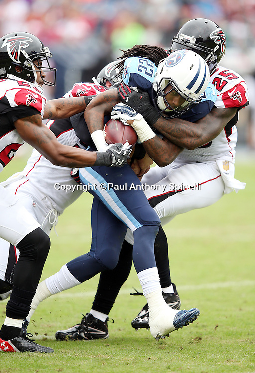 Tennessee Titans running back Dexter McCluster (22) gets gang tackled on a first quarter third down stop by Atlanta Falcons cornerback Robert Alford (23), Atlanta Falcons strong safety William Moore (25), and Atlanta Falcons linebacker Paul Worrilow (55) during the 2015 week 7 regular season NFL football game against the Atlanta Falcons on Sunday, Oct. 25, 2015 in Nashville, Tenn. The Falcons won the game 10-7. (©Paul Anthony Spinelli)