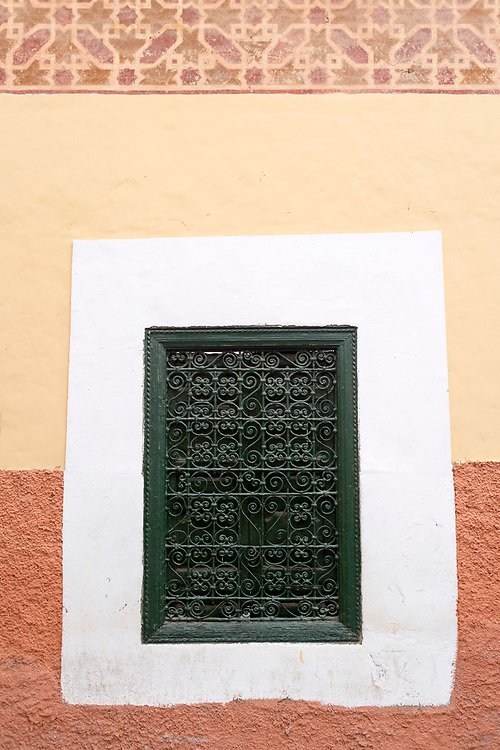 MARRAKESH, MOROCCO - 19TH APRIL 2016 - Window shutter on the exterior side of the Zaouia / zawiya burial tomb shrine site of Sidi Abdel Aziz, Marrakesh, Morocco.