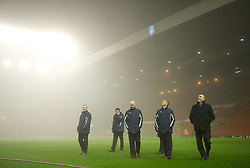 LIVERPOOL, ENGLAND - Monday, February 6, 2012: Match referee Michael Oliver and his team inspect the fog rolling in off the River Mersey at Anfield before the Premiership match against Tottenham Hotspur at Anfield. (Pic by David Rawcliffe/Propaganda)