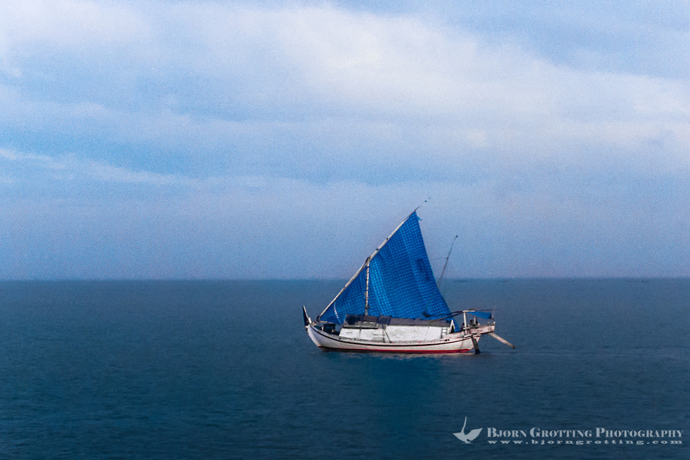 Java. East coast of Java. A Pinisi sailing vessel on its way to Surabaya with cargo (from helicopter).