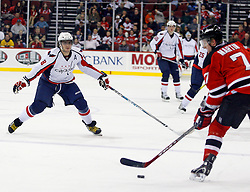 December 7, 2007; Newark, NJ, USA;  Washington Capitals left wing Alexander Ovechkin (8) plays defense on New Jersey Devils defenseman Paul Martin (7) during the first period at the Prudential Center in Newark, NJ.