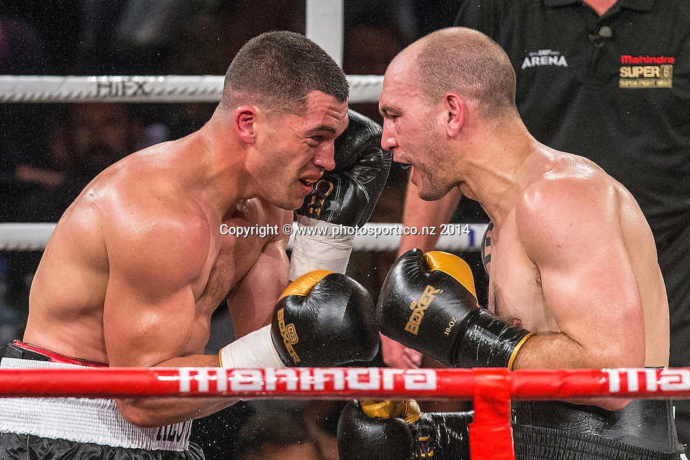 David Aloua (L) fights Anthony McCracken in the Mahindra Super 8 Fight Night, North Shore Events Centre, Auckland, New Zealand, Saturday, November 22, 2014. Photo: David Rowland/Photosport