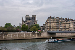 The Notre Dame Cathedral is still standing despite major damage caused by a giant fire. French President Emmanuel Macron vowed to rebuild the 13th century building that welcomes tens of millions of worshippers and tourists per year. Paris, France, April 16, 2019. Photo by Samuel Boivin/ABACAPRESS.COM