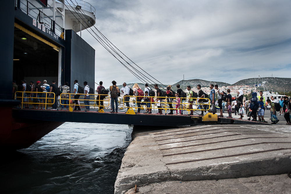 Refugees and migrants barding a boat at the port of Mytiline that will take them to the Greek mainland.