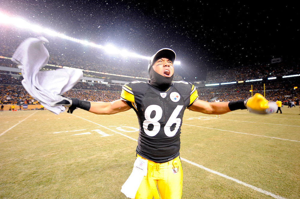 PITTSBURGH - JANUARY 18: Hines Ward #86 of the Pittsburgh Steelers celebrates on the field after defeating the Baltimore Ravens during the AFC Championship Game on January 18, 2009 at Heinz Field in Pittsburgh, Pennsylvania. The Steelers defeated the Raves 23 to 14 to advance to Super Bowl XLIII. (Photo by Rob Tringali//) *** Local Caption *** Hines Ward